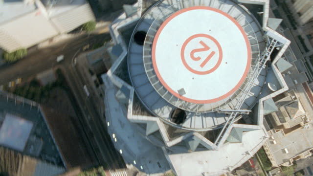 stockvideo's en b-roll-footage met an aerial view reveals a heliport atop the us bank tower in los angeles, california. - us bank tower