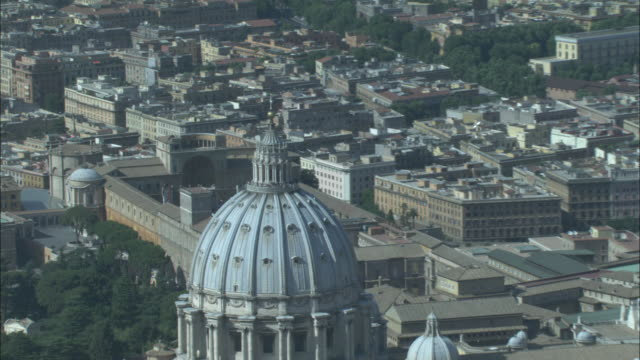 an aerial view reveals saint peter's basilica in vatican city. - state of the vatican city stock videos & royalty-free footage