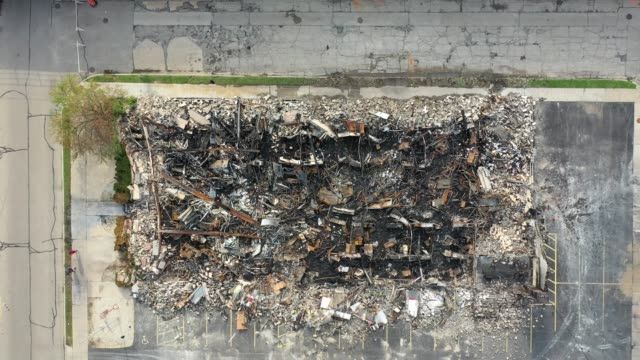an aerial view shot with a drone shows a department of corrections building reduced to rubble by fire following another night of unrest on august 25... - back to front stock videos & royalty-free footage