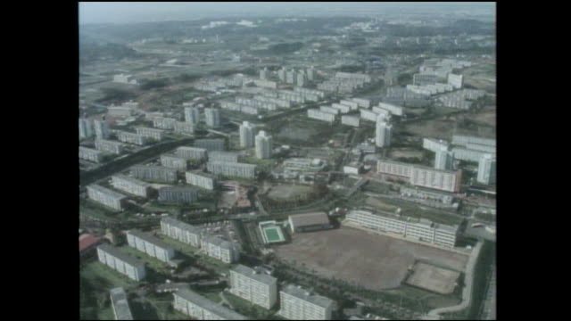 stockvideo's en b-roll-footage met an aerial view shows high rises in the tama new town housing development in tokyo, japan. - breedbeeldformaat