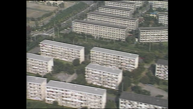 an aerial view shows high rises in the tama new town housing development in tokyo, japan. - anno 1987 video stock e b–roll