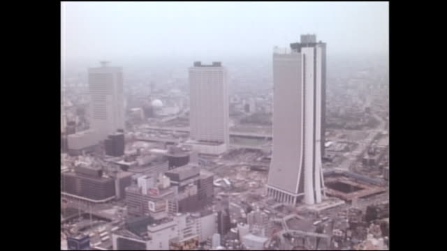 vidéos et rushes de an aerial view shows skyscrapers in the nishi-shinjuku business district in tokyo, japan. - 1976