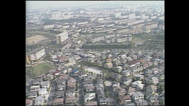 an aerial view shows tama new town and the surrounding areas in tokyo, japan. - 1987 stock-videos und b-roll-filmmaterial