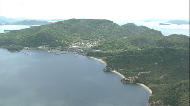 an aerial view shows teshima island in the inland sea of japan. - island stock videos & royalty-free footage