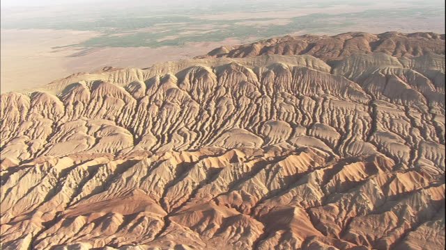 An aerial view shows the eroded red sandstone of the Flaming Mountains in Xinjang Uyghur Autonomous Region Silk Road China