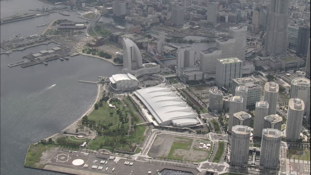 an aerial view shows the harbor and the minato mirai 21 area in yokohama, japan. - yokohama stock videos and b-roll footage