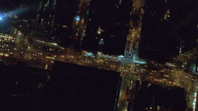 an aerial view shows the manhattan skyline, including the empire state building at night. - citigroup center manhattan stock videos & royalty-free footage