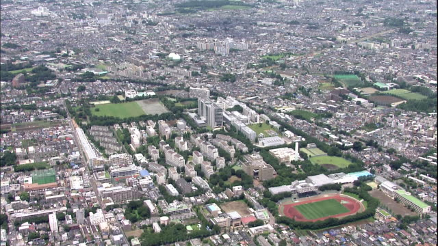 An aerial view shows the Musashino City Government Office and surrounding areas in Japan.