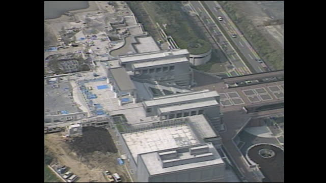 an aerial view shows the tama center station and parthenon tama in tokyo, japan. - 1980~1989年点の映像素材/bロール