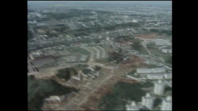 an aerial view shows the tama new town housing development in tokyo, japan. - 1980~1989年点の映像素材/bロール