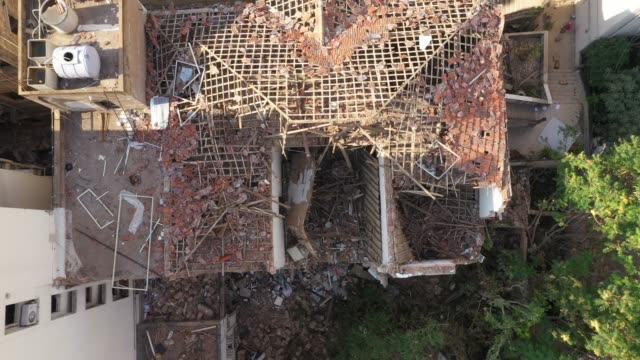 an aerial view through the collapsed roof of a residential building, damaged in last week's explosion, on august 12, 2020 in beirut, lebanon. the... - ruined stock videos & royalty-free footage