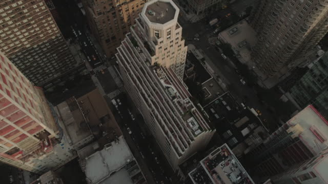 an aerial view tilting up over manhattan buildings on the upper east side. new york. usa. - tilt up stock videos & royalty-free footage