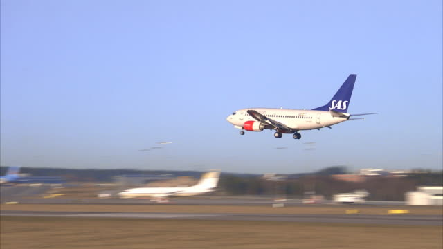 An aeroplane arriving to an airport Sweden.