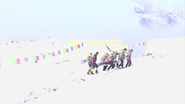 An AFP team had just reached Everest base camp on assignment when an avalanche triggered by the 78 magnitude quake that has killed more than 5000 in...