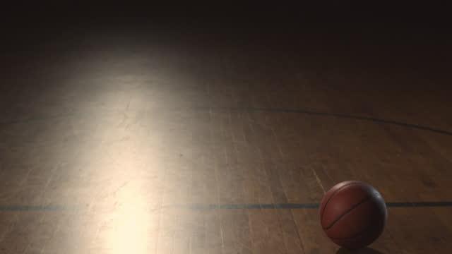 vídeos y material grabado en eventos de stock de slo mo. an african american basketball player in uniform finishes dribbling and leaves the ball bouncing on the court. - jugador de baloncesto
