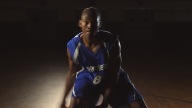 an african american basketball player practices quick dribbling techniques and passes. - passing sport stock videos and b-roll footage