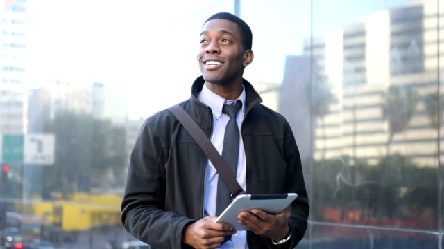 An African American Businessman with a Mobile Device in Downtown Los Angeles