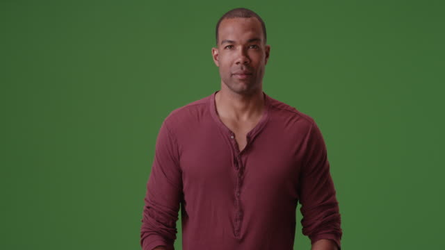 an african american man posing for a portrait on green screen - car chroma key stock videos & royalty-free footage