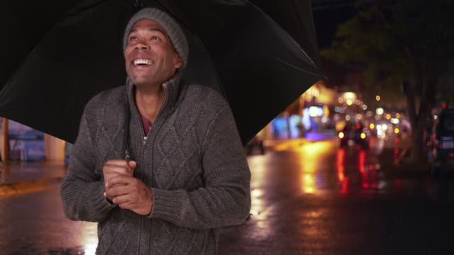 an african american man takes a selfie in the rain - independence stock videos & royalty-free footage