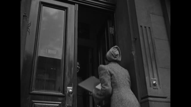 an african american woman in a tweed outfit climbs stars to harlem brownstone / census worker talks with another black woman / census taker talks... - census stock videos & royalty-free footage