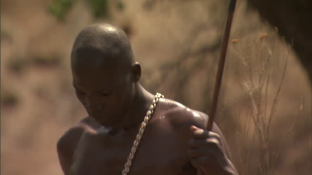 an african warrior carries a box in one hand. - warrior person stock videos & royalty-free footage