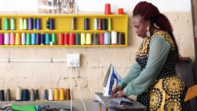 an african woman making face masks in her fashion design studio. - owner stock videos & royalty-free footage