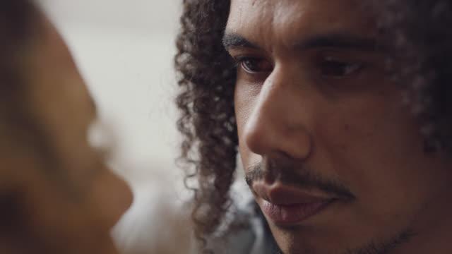 vídeos de stock e filmes b-roll de cu of an african-american man's face while he consoles his upset girlfriend - resultado de exame