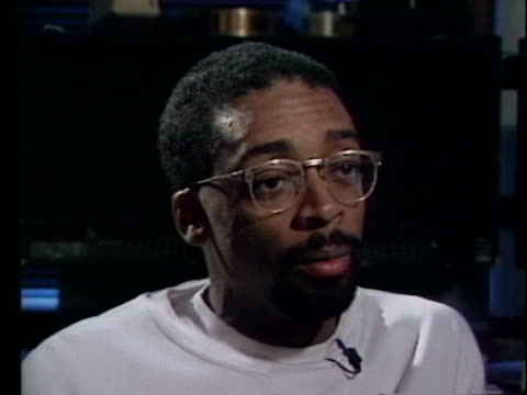 """an african-american student criticizes director spike lee's controversial film """"school daze,"""" and spike lee comments. - stereotypical stock videos & royalty-free footage"""