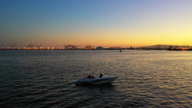 an afternoon boating in the long beach harbor at sunset. - long beach california stock videos & royalty-free footage