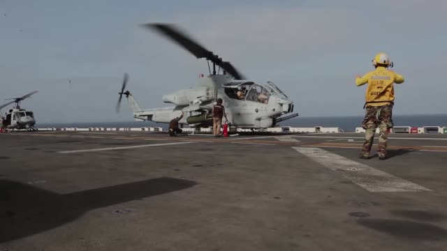 an ah1w super cobra with marine medium tiltrotor squadron 261 conducts flight operations aboard the uss iwo jima sept 4 2012 the cobras are part of... - attack helicopter stock videos and b-roll footage