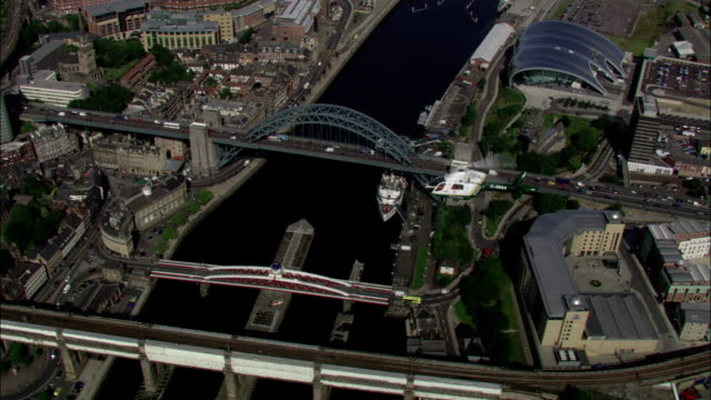 an air ambulance hovers above the tyne bridge available in hd. - newcastle upon tyne stock videos and b-roll footage