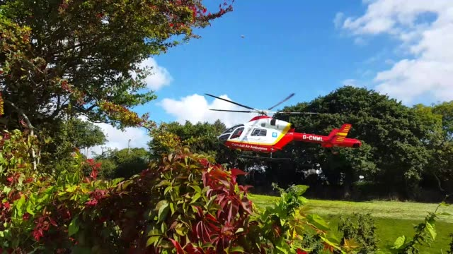 stockvideo's en b-roll-footage met an air ambulance lands in a field close to this house in order to transport a patient as fast as possible to the hospital the journey by road is 25... - overige