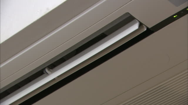An air conditioner ceiling vent moves slowly.