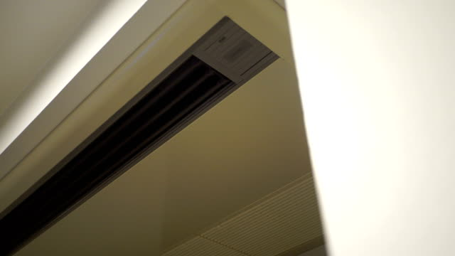an air conditioner vent slowly opens. - air duct stock videos & royalty-free footage