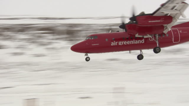 an air greenland passenger aircraft comes into land at an airport in the qaasuitsup region of greenland.  - propeller aeroplane stock videos & royalty-free footage