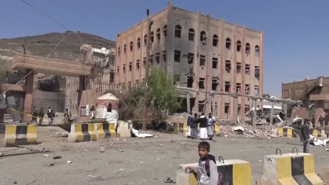 vídeos de stock, filmes e b-roll de an air raid hit the criminal investigations unit in yemen's rebel held capital sanaa on sunday as insurgents battle the government backed by a saudi... - air raid