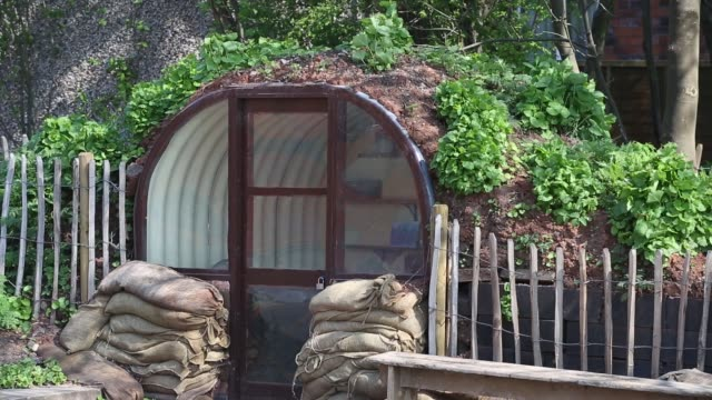 an air raid shelter as part of a second world war display at quorn and woodhouse station on the great central railway, leicestershire, uk. - bomb shelter stock videos & royalty-free footage