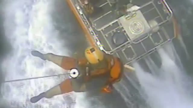 stockvideo's en b-roll-footage met an air station corpus christi mh-65 dolphin helicopter crew assists mariners in two incidents in the gulf of mexico on the 1st day of the great texas... - padre