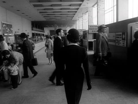 an air stewardess walks through the terminal building at london airport - air stewardess stock videos & royalty-free footage