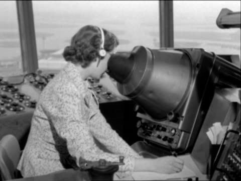 an air traffic controller looks into a radar device at london airport. - radar stock videos & royalty-free footage