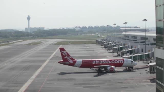 An AirAsia Bhd aircraft stands on the tarmac at Kuala Lumpur International Airport 2 in Sepang Selangor Malaysia on Thursday May 25 2017