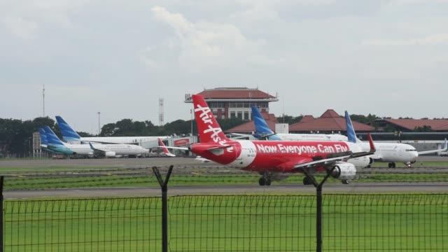 an airasia bhd. aircraft taxis on the runway at soekarno hatta international airport in cengkareng, near jakarta, indonesia, on monday, dec. 29 an... - jakarta stock videos & royalty-free footage