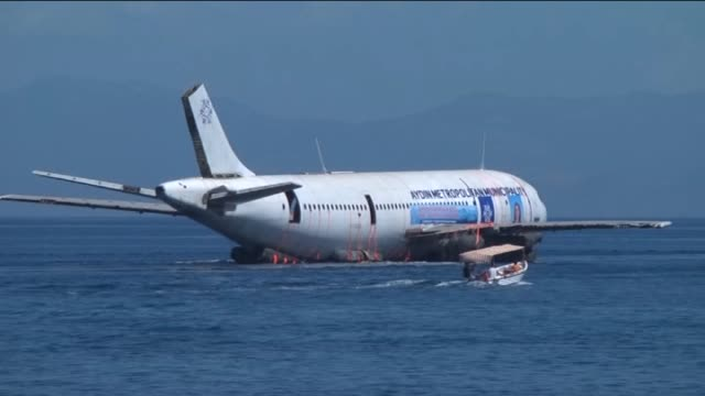 an airbus a300 plane will be sunk in the waters of the aegean sea off the coast of kusadasi near turkey's izmir province on june 04 2016 as part of a... - aydın province stock videos and b-roll footage