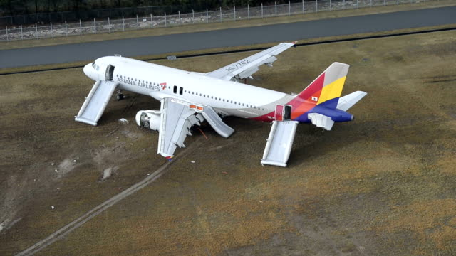 an airbus a320 flown by asiana airlines from seoul ran out of runway soon after landing at hiroshima airport on tuesday the transport ministry and... - tail wing stock videos and b-roll footage