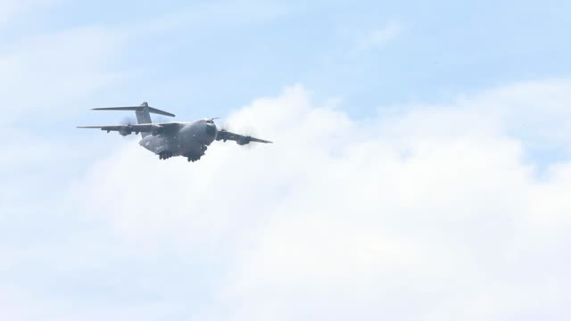 an airbus a400m military aircraft performs a flying display on day two of the 51st international paris air show in paris france on tuesday june 16... - airbus stock-videos und b-roll-filmmaterial