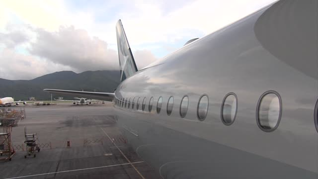 an airbus group se a350900 aircraft operated by cathay pacific airways ltd stands during a launch ceremony at the hong kong international airport in... - symbol stock-videos und b-roll-filmmaterial