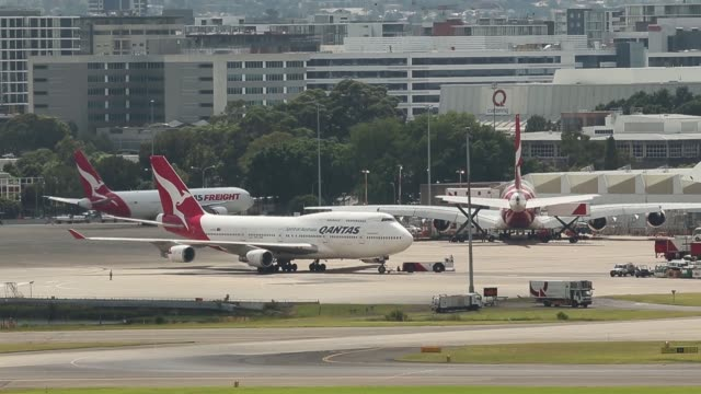 An Airbus SAS A330200 aircraft operated by Qantas Airways Ltd is parked at a teminal at Sydney Airport in Sydney Australia on Monday Feb 22 A Boeing...