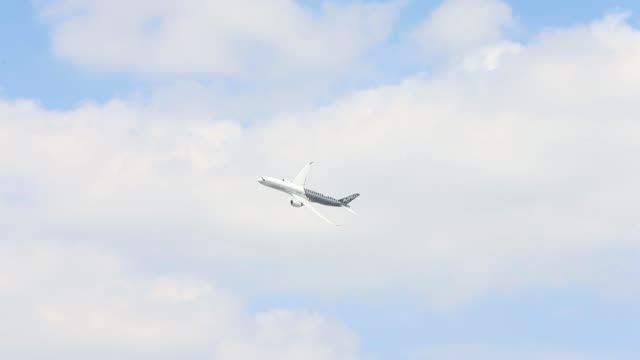 an airbus sas a350 xwb aircraft performs a flying display on the opening day of the 51st international paris air show in paris, france, on monday,... - day 1 stock videos & royalty-free footage