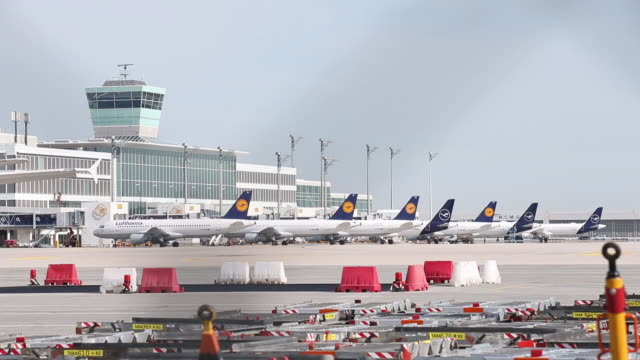 stockvideo's en b-roll-footage met an airbus se a350-900 'braunschweig' passenger aircraft, operated by deutsche lufthansa ag, stands on the tarmac ahead of a long haul flight to los... - münchen vliegveld