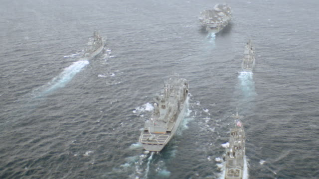 an aircraft carrier leads a naval task force. - convoy stock videos & royalty-free footage